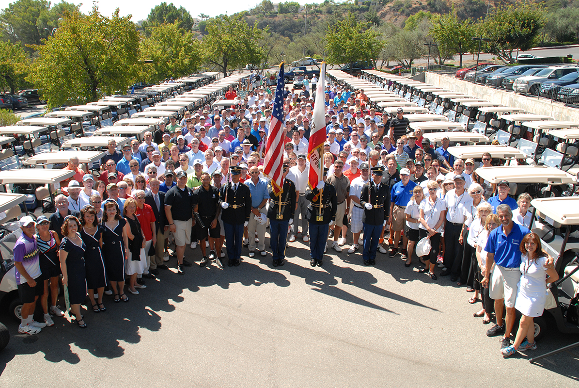 The Color Guard is formed up to the middle of the participants and guests of honor at the opening ceremonies for the 2014 MVAT Golf and Tennis Classic.